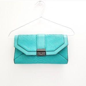 BCBGMaxAzria Bags - BCBG Clutch / Shoulder / Crossbody Bag
